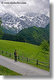 europe, hikers, hiking, logarska dolina, mountains, photographers, roads, slovenia, snowcaps, vertical, photograph