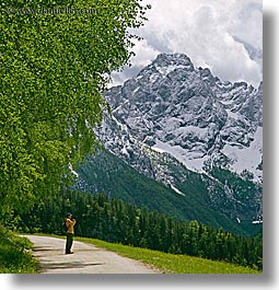 europe, hikers, hiking, logarska dolina, mountains, photographers, roads, slovenia, snowcaps, square format, photograph