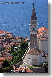 bell towers, buildings, churches, cityscapes, europe, pirano, slovenia, vertical, water, photograph
