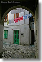 archways, clothes, cobblestones, europe, hangings, laundry, pirano, slovenia, vertical, windows, photograph