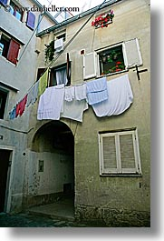 archways, clothes, europe, hangings, laundry, pirano, slovenia, vertical, windows, photograph