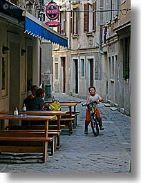 bicycles, boys, childrens, cobblestones, europe, people, pirano, slovenia, vertical, photograph