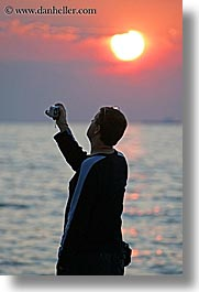 cameras, europe, men, ocean, people, photographers, pirano, slovenia, sunsets, vertical, water, photograph