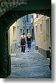 archways, cobblestones, europe, girls, people, pirano, slovenia, teenage, teenagers, vertical, photograph