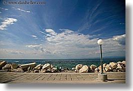 clouds, europe, horizontal, lamp posts, ocean, pirano, shoreline, slovenia, sunbathers, water, photograph