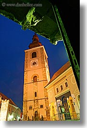 bell towers, buildings, europe, long exposure, nite, ptuj, slovenia, statues, towns, vertical, photograph
