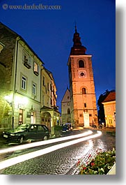 bell towers, buildings, cars, europe, long exposure, motion blur, nite, ptuj, slovenia, streaks, towns, vertical, photograph