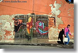 doors, europe, graffiti, horizontal, men, ptuj, slovenia, walking, photograph