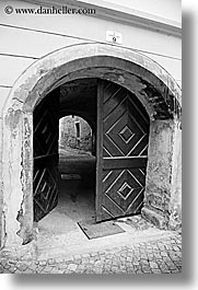 archways, black and white, cobblestones, doors, europe, ptuj, slovenia, vertical, photograph