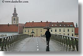bridge, europe, horizontal, men, ptuj, rain, slovenia, walking, photograph