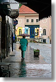cobblestones, europe, ptuj, rain, slovenia, umbrellas, vertical, walking, womens, photograph