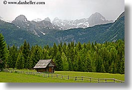 barn, europe, fences, fields, horizontal, mountains, slovenia, snowcaps, triglavski narodni park, photograph