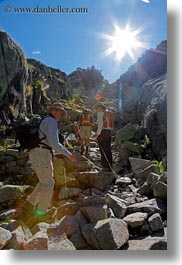 activities, aiguestortes hike, europe, hikers, hiking, mountains, nature, people, rocks, spain, sun, vertical, photograph