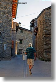 estamariu, europe, men, spain, streets, vertical, walking, photograph
