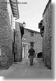 black and white, estamariu, europe, men, spain, streets, vertical, walking, photograph
