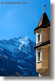 buildings, eiger, europe, grindelwald, mountains, nature, snowcaps, switzerland, vertical, photograph
