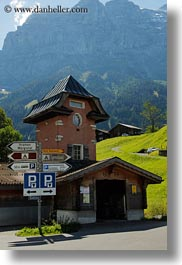 europe, grindelwald, houses, humor, signs, switzerland, vertical, photograph