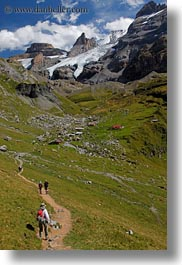 clouds, europe, hikers, hiking, kandersteg, lake oeschinensee, mountains, nature, people, sky, snowcaps, switzerland, vertical, photograph