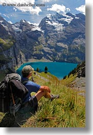 clouds, europe, hikers, kandersteg, lake oeschinensee, lakes, men, mountains, nature, oeschinensee, people, sky, snowcaps, switzerland, vertical, photograph
