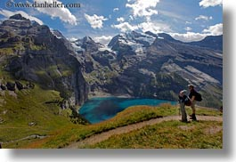 clouds, europe, hikers, horizontal, kandersteg, lake oeschinensee, lakes, mountains, nature, oeschinensee, people, sky, snowcaps, switzerland, photograph