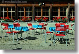 blues, chairs, europe, flowers, geraniums, horizontal, kandersteg, lake oeschinensee, nature, red, switzerland, tables, windows, photograph