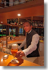 bartender, beers, emotions, europe, kandersteg, men, people, serving, smiles, switzerland, vertical, wald hotel doldenhorn, photograph