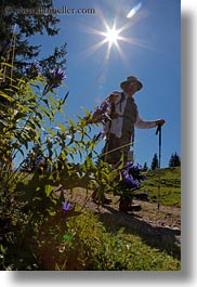 europe, hikers, hiking, lucerne, men, mt rigi, people, sun, switzerland, vertical, photograph
