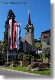 churches, europe, flags, lucerne, steeples, switzerland, vertical, weggis, photograph
