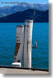 europe, lucerne, piers, pylons, switzerland, vertical, weggis, photograph