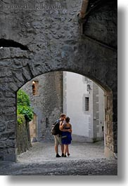 archways, chateau de chillon, couples, europe, kissing, men, montreaux, people, switzerland, under, vertical, womens, photograph