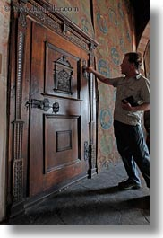 chateau de chillon, doors, europe, men, montreaux, ornate, people, switzerland, vertical, photograph