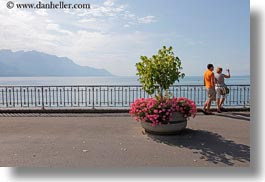 cameras, couples, europe, flowers, horizontal, lakes, men, montreaux, people, switzerland, womens, photograph