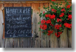 cheese, europe, flowers, geraniums, horizontal, murren, signs, switzerland, photograph