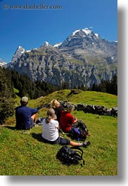 europe, groups, hikers, men, mountains, murren, nature, people, picnic, snowcaps, switzerland, vertical, womens, photograph