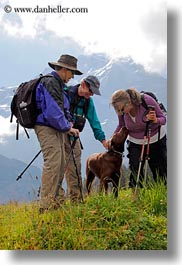 dogs, emotions, europe, groups, happy, hikers, laugh, men, people, playing, smiles, switzerland, vertical, womens, wt people, photograph