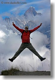 clouds, emotions, europe, happy, hikers, jumping, men, mountains, nature, people, roberts, sky, smiles, snowcaps, switzerland, vertical, wt people, photograph