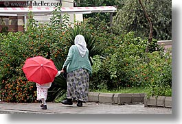 europe, fethiye, girls, grandmother, horizontal, red, turkeys, umbrellas, photograph