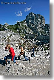 amphitheater, europe, termessos, tourists, turkeys, vertical, womens, photograph