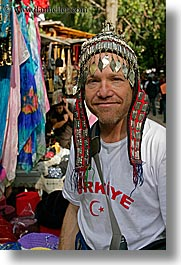 dans, europe, groups, head dress, men, people, shirts, tourists, turkeys, vertical, photograph