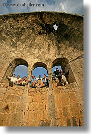 arches, architectural ruins, europe, groups, hands, happy, laugh, people, tourists, tours, turkeys, vertical, windows, photograph