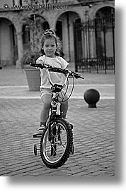 bicycles, black and white, caribbean, childrens, cuba, girls, havana, island nation, islands, latin america, people, south america, vertical, photograph