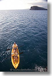boats, ecuador, equator, galapagos, galapagos islands, islands, kayaks, latin america, ocean, pacific ocean, south pacific, vertical, water, photograph