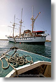 boats, ecuador, equator, galapagos, galapagos islands, islands, latin america, ocean, pacific ocean, ropes, sagitta, sails down, south pacific, vertical, water, photograph