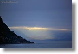cliffs, ecuador, equator, galapagos islands, horizontal, latin america, santa cruz, sunbeams, photograph