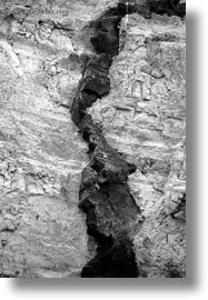 black and white, cliffs, dike, ecuador, equator, galapagos islands, latin america, santa cruz, vertical, volcanic, photograph