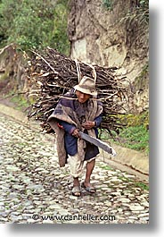 bearing, ecuador, equator, latin america, people, sticks, vertical, photograph