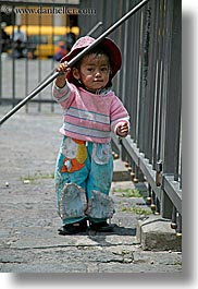 blues, childrens, clothes, colors, ecuador, equator, fences, girls, hats, latin america, pink, quito, toddlers, vertical, photograph