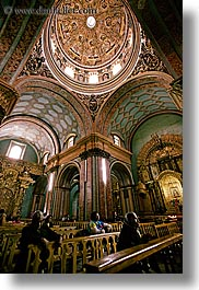 arches, archways, buildings, churches, domes, ecuador, equator, latin america, people, praying, quito, religious, structures, vertical, photograph