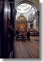 buildings, churches, domes, doors, ecuador, equator, knees, latin america, materials, people, praying, quito, religious, slow exposure, structures, vertical, woods, photograph