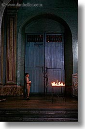 archways, buildings, candles, churches, doors, ecuador, equator, latin america, materials, praying, quito, religious, structures, vertical, womens, woods, photograph